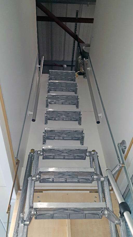 Supreme loft ladder with deep hatch. Shown with additional treads and grab rail.