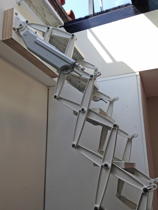 Skylight access loft ladder. Elite loft ladder from Premier Loft Ladders