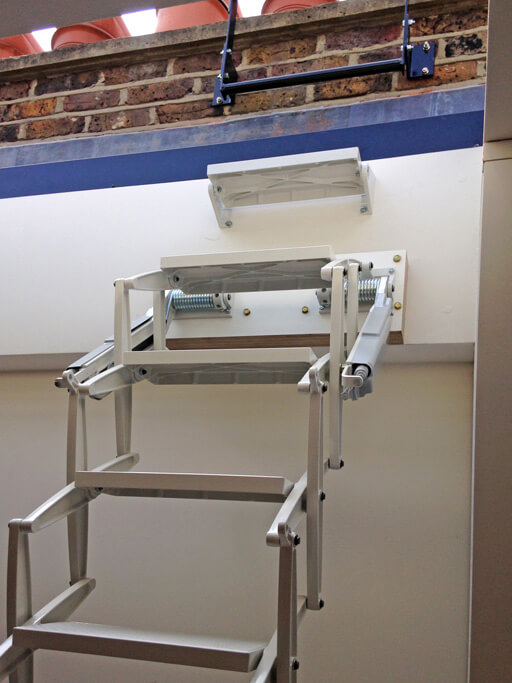Elite loft ladder for access to rooflight. Grey white powder coat finish to match the decor.