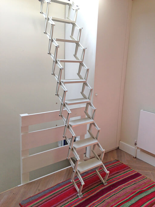 Elite concertina loft ladder for access to skylight over staircase.