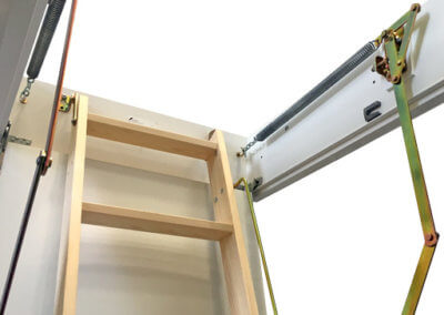 Spring counter balance makes opening and closing the wooden loft ladder easier