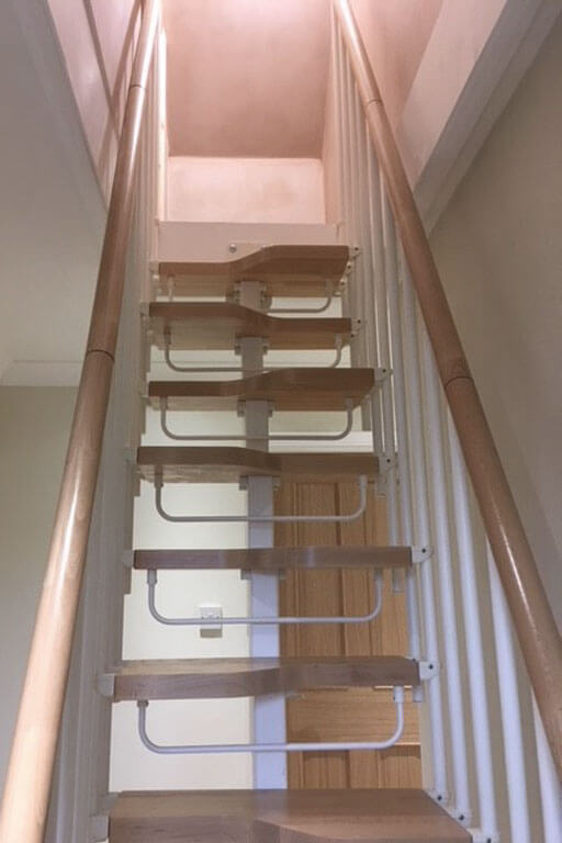 Compatta loft conversion stairs with two handrails and safety riser bars