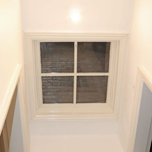 Glass loft hatch in Victorian home