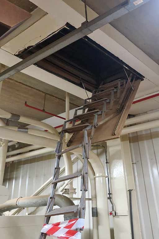 Broken retractable roof access ladder. Damaged after being hit.