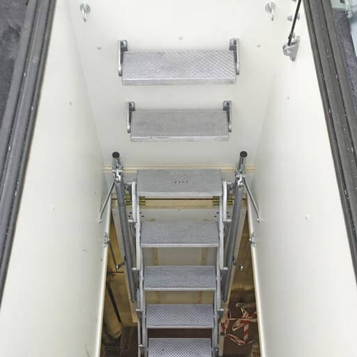 Retractable roof access ladder and hatch. Providing access for maintenance of roof top equipment. Premier Loft Ladders case study