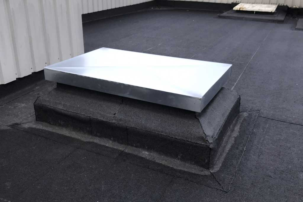 Weather proof roof access hatch. Premier Loft Ladders case study