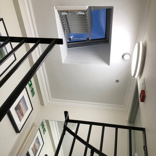 Piccolo Premium concertina loft ladder installed beneath a roof light. Premier Loft Ladders case study