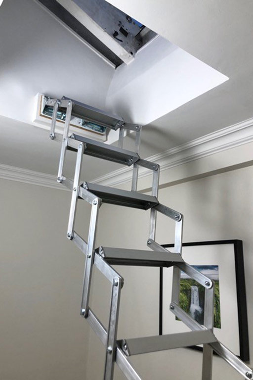 Piccolo Premium loft ladder fitted beneath a small roof light